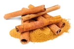 Cinnamon - sticks and powder  isolated on white